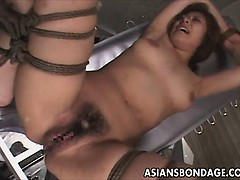 Asian restrain bondage scene with cable suspension