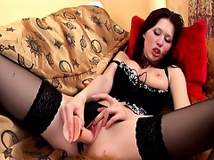 redhead-in-thigh-highs-teases-and-masturbates