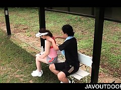 asian-teeny-massaging-her-coach-and-giving-him-boner-outdoor