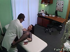 brunette-rubs-pussy-with-massage-tool-at-her-doctor