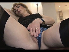 mature-english-blonde-babe-in-stockings-upskirt-tease