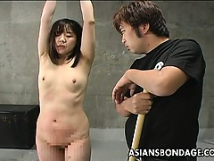 asian-chick-is-tied-up-and-caned-hard