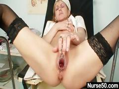 skinny-milf-nora-opens-pussy-with-speculum-spreader