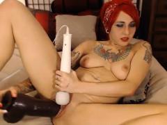 hot-tattoo-babe-enjoys-her-huge-dildo