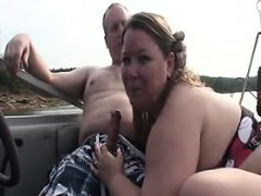 bbw-gives-a-blowjob-outside-on-a-boat