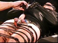 totally-bound-hunk-in-leather-straitjacket-in-cbt-with-high