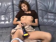 japanese-milf-masturbating-with-a-machine