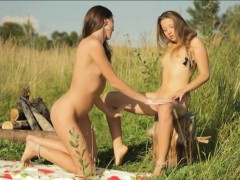 two-teens-intimate-lesbo-sex-while-having-a-picnic-outdoors
