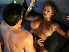 red-haired-milf-with-big-tits-rides-him