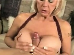 grandma-with-fake-breasts-pleasing-a-cock