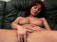 redhead-mature-caregiver-plays-lonely-on-the-couch
