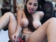 asian-slut-with-large-breasts-masturbating