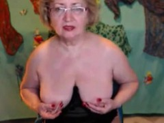 Solo granny fingers herself her pussy