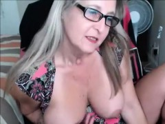 kinky granny with glasses on webcam teasing