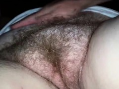 rubbing-and-fingering-a-hairy-mature-vagina