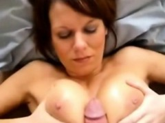 busty-mama-takes-a-huge-load-on-her-boobs