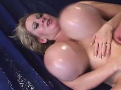 giant-oiled-boobed-blonde
