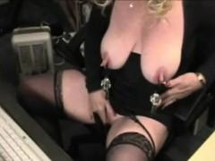 big-breasted-blonde-enjoys-rubbing-a-dildo-against-her-huge