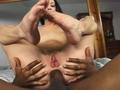 cute slender brunette buries a massive black penis inside her tight ass