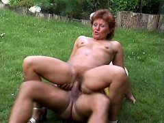 naughty-mature-woman-has-a-stiff-cock-drilling-her-holes-in-the-garden