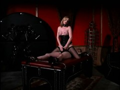 Dominatrix Has Tied Up Her Slave On A Table And Fingers Her Slit
