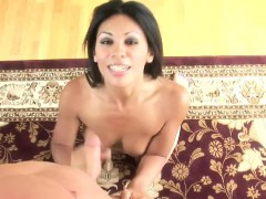beautiful exotic brunette does her best to jerk off a big penis