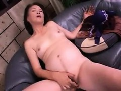 asian-cougar-with-tiny-tits-spreads-her-legs-to-stroke-her