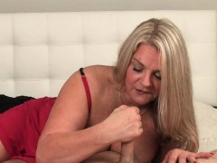 busty-mature-sensually-rubbing-hard-cock-pov