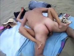 two dude banging her in the seaside