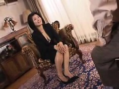 attractive-oriental-housewife-displays-her-sexy-legs-and-bi