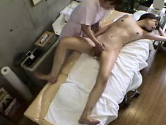 petite-asian-girl-lies-naked-on-the-massage-table-and-is-ma
