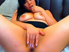 sexy brunette masturbates with a dildo on the couch