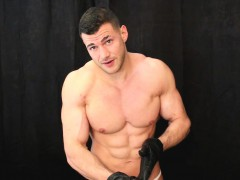 muscle-hunk-wanks-with-leather-gloves-and-eats-cum
