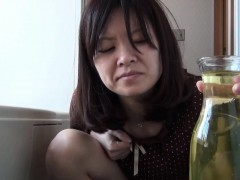 asian babe pees in vase