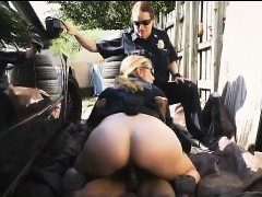 two-white-cops-splitting-big-black-dick-together-outdoors
