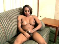horny-ts-gets-her-black-skin-covered-in-lotion-and-wanks-off
