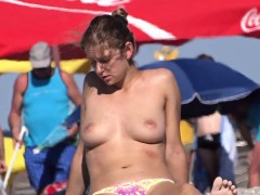 sexy amateur topless woman voyeur beach close-up