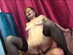busty-brunette-granny-riding-long-shaft-on-couch