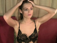 petite blonde girl with a pretty smile exposes herself on t