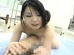 alluring-japanese-masseuse-pleases-a-stiff-cock-with-her-gi
