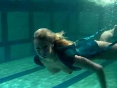 Blonde Feher with big firm tits underwater