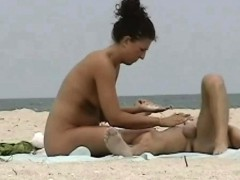 peeping at a hot nudist couple on the beach Hot