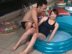 asian-sex-doll-in-plastic-pool-gets-tits-and-cunt-teased