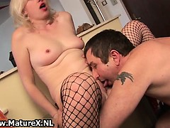 mature-blond-girl-giving-boob-job-part2