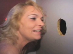 blonde amateur blowing strangers off through glory hole