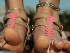Wearing Sandals On Her Beautiful Feet Outside