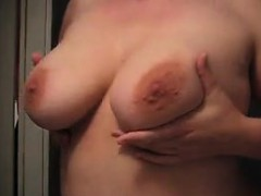 attractive-lady-sensually-massages-her-big-natural-tits-for