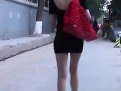 Hot Oriental Woman Walking In Minidress