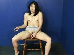 fantastic asian babe rubbing on her wet cunt all alone