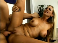 Striking blonde with big hooters welcomes a long pole up her needy ass